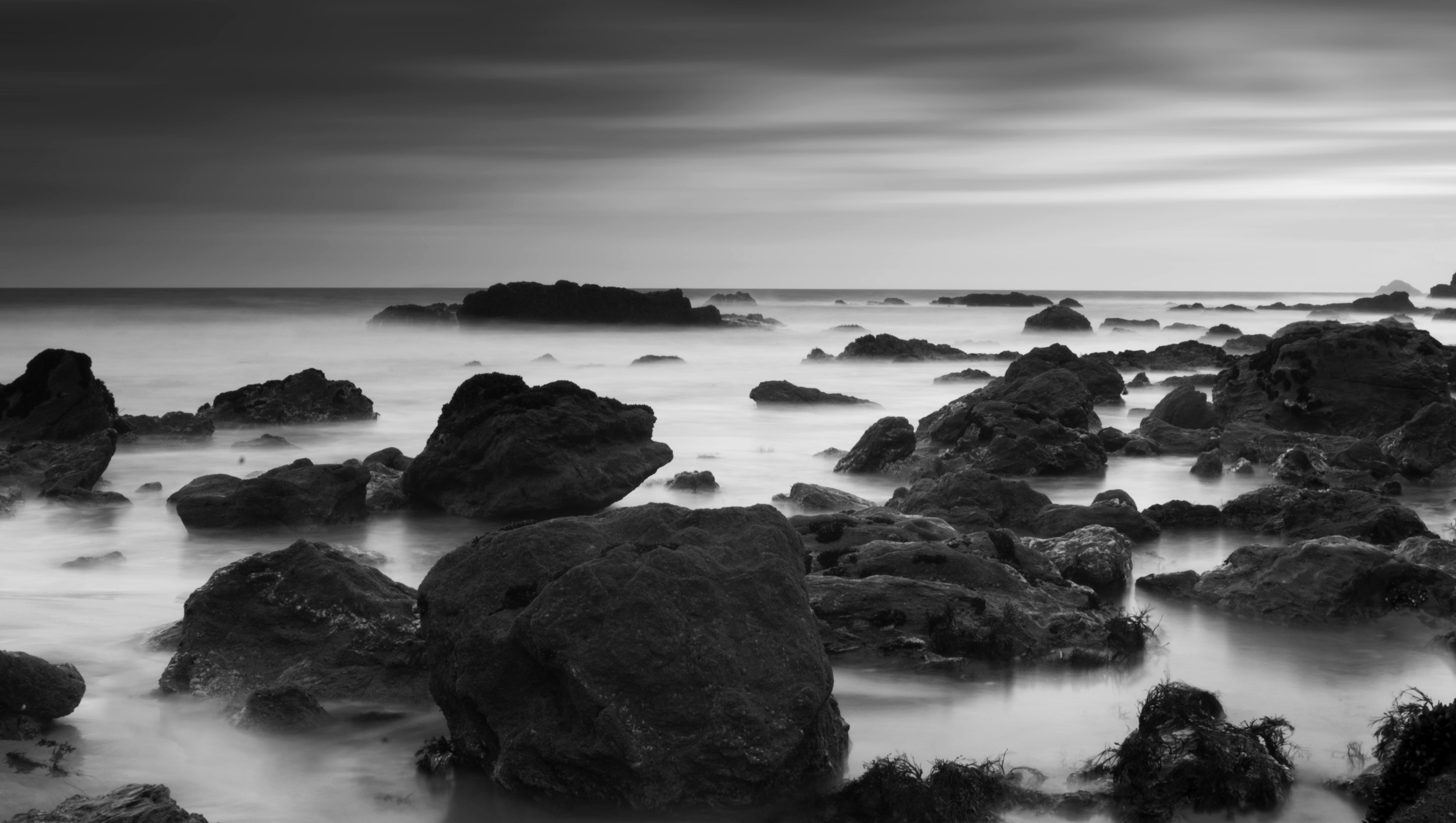 black and while shoreline with rocks